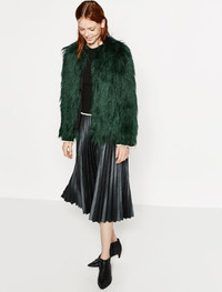 Fashion gets soft and cozy in faux fur. Short faux fur jacket at www.zara.com.