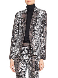 Animal prints roam in exotic patterns this spring for a winning look from St. John Knits. www.stjohnknits.com.