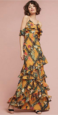 Bold florals flourish in spring's best dresses. Pictured is a ruffled maxi dress in one of the season's hottest hues, sunflower yellow, by PatBO at Anthropologie.
