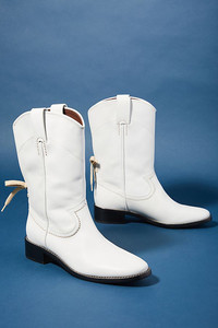 White boots are a surprising fall fashion trend, and western boots step out in front. See these boots by Chloe Annika at Anthropologie. www.anthropologie.com.