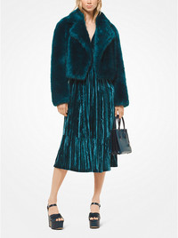 Invest in faux fur pieces with flattering, sleek silhouettes. This teal faux fur jacket is from Michael Kors. www.michaelkors.com.