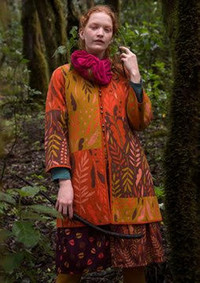 Color and pattern liven up sweaters this fall. This knit cardigan is by Swedish designer Gudrun Sjoden. www.gudrunsjoden.com.