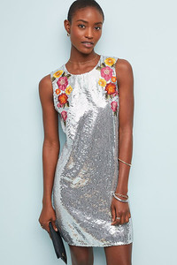 The sequins are sparkling at holiday parties. Silver sheath dress at www.anthropologie.com.