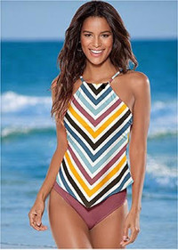 Rainbow stripes hit the beach this spring and summer in swimwear of all styles and shapes. Shown: High-neck hanky-hem tankini from Venus.
