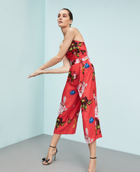 Jump into wide-leg pants for the summer ahead. Ted Baker floral jumpsuit at Bloomindale's.