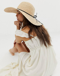 For the ultimate in style and sun protection, try a floppy wide-brimmed straw hat this summer. Hat shown from Asos.