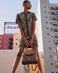 Start prepping your shopping list for fall now. Leopard prints roar into fall. Shown: Michael Kors backpack and sneakers.