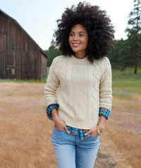 Combine comfy and stylish by layering a fisherman sweater over a plaid shirt. Sweater from L.L.Bean.