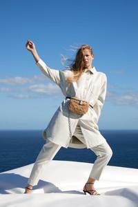 Faux fur is a fuzzy trend in handbags this fall. Crossbody belt bag from Zara.