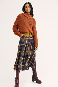 Autumn in the country. Think chunky sweaters and plaid skirts with an uptown vibe. Sweater from Free People.