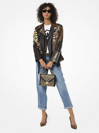 Animal prints roar this fall in a patchwork leather jacket by Michael Kors