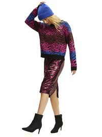 Metallics shine on for holiday parties. Scoop ombre zebra sweater and sequined skirt at Walmart.