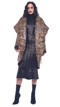 Wear a statement coat to reinvent a little black party dress. Animal print shawl collar coat by Norma Kamali.