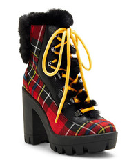 Hike down the city streets in style with plaid boots by Jessica Simpson.