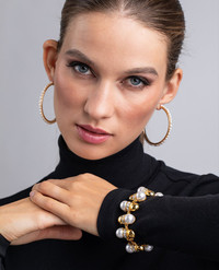 Pearls get a modern touch this spring in updated oversized hoops and bracelets at Kenneth Jay Lane.
