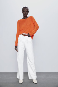 Want an instant update to your spring wardrobe? Add a belt! Orange knit sweater, pants and belt from Zara.