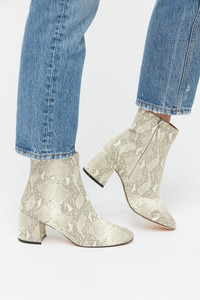 Lighten up with white embossed ankle boots for spring from Urban Outfitters.