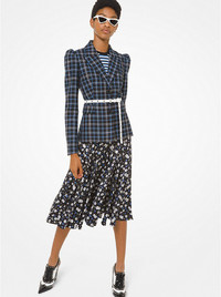 Rework your work wardrobe this spring by mixing prints and patterns. Plaid jacket, striped shirt and floral skirt from Michael Kors' spring collection.