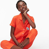 Get comfortable in bright neon colored pajamas. Cotton pajamas with bowling-inspired top from J.Crew.
