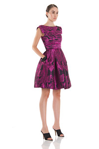 Pantone's color of the year, Radiant Orchid, blooms in resort and spring collections. Featured: Theia's printed silk organza cocktail dress.