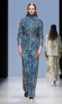 Shop for designer looks at budget prices. Stores like H&M regularly feature designer collections at affordable prices. Shown: From the collection of the winner of the H&M Design Award 2014, Eddy Anemian, a 24-year-old student at La Cambre in Brussels.