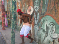 A dancer performs in front of a mural at the Callejon de Tradiciones Community Project in the city of Matanzas near Havana, Cuba. Photo courtesy of Beverly Mann.