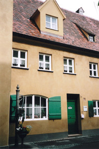 The charming cottages at the Fuggerei in Augsburg, Germany, are well kept by residents who pay an annual rent of 88 euro cents, or about $1.20. Photo courtesy of Sharon Whitley Larsen.