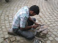 This key-maker's workplace is on a busy street in Kolkata, India. Photo courtesy of Barbara Selwitz.