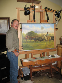 Former cowboy Jack Terry poses by one of his Western paintings in his Fredericksburg, Texas, studio.  Photo courtesy of Glenda Winders.