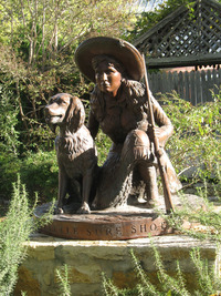 John Bennett's sculpture of Annie Oakley graces the garden outside his Agave Gallery in Fredericksburg, Texas. Photo courtesy of Glenda Winders.