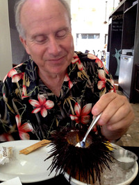 The author dines on a sea urchin, a specialty at the Hungry Cat in Santa Barbara, California. Photo courtesy of Jim Farber.