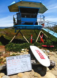 """A sign at a lifeguard station in Santa Barbara, California, reports surfing conditions and admonishes visitors to """"Have fun!"""" Photo courtesy of Jim Farber."""