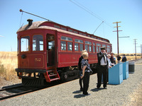 Volunteer conductor Fred Codoni explains the exhibits at Pantano, the halfway stop for the Peninsular Railway's interurban excursion in Northern California. Photo courtesy of Patricia Arrigoni.
