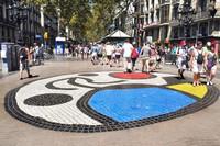 A mosaic by popular Spanish artist Joan Miro lies in the Rambles area of Barcelona. Photo courtesy of Dreamstime.com/Juan Moyano.