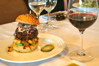 Burger de la Casa is paired with a delicious merlot at a tasting lunch at Tierra Sur inside Herzog Wine Cellars in Oxnard, California. Photo courtesy of Kim Tracy Prince.