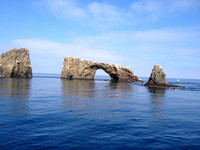 Arch Rock near Oxnard, California, is one of the natural wonders you can see up close from the deck of the Island Packers Wildlife Cruise.Photo courtesy of Kim Tracy Prince.