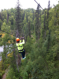A woman zips through the forest and off the grid in lush Talkeetna, Alaska. Photo courtesy of Lesley Sauls.