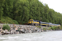 The last flag-stop train in North America runs along the Susitna River into the wilderness where roads don't reach and the only way to get to town is by flagging down a train. Photo courtesy of Lesley Sauls.