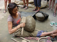 A young woman in the village of Yandabo begins to fashion a pot from clay taken from the river. Photo courtesy of Sandra Scott.