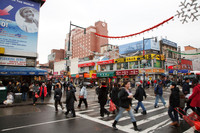 Multiethnic businesses on this busy street in Queens, New York, are a draw to visitors from all over the world. Photo courtesy of Victor Block.
