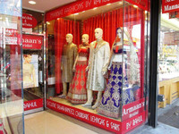 Stores selling a wide variety of wares, such as this one with Indian clothing on offer, welcome shoppers in Queens, New York. Photo courtesy of Victor Block.