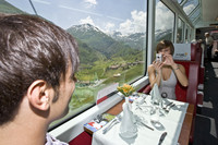 A couple enjoy a trip on the Glacier Express through the Swiss Alps. Photo courtesy of the Glacier Express.