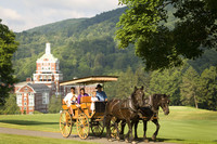 Guests explore the grounds of the Omni Homestead Resort in Hot Springs, Virginia, by way of an old-fashioned carriage ride. Photo courtesy of Omni Homestead Resort.