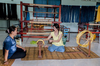 These women are weaving silk into thread at the Queen Sirikit Sericulture Center in northeast Thailand. Photo courtesy of Ellen Clark.