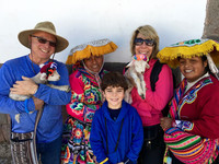 The author and her family meet some baby llamas and their caretakers during their South American adventure. Photo courtesy of Margot Black.