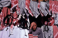 A Jordanian merchant offers keffiyeh, the traditional headdress, to potential customers. Photo courtesy of www.hansentravel.org.