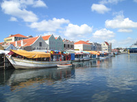 A floating market lies close to the Queen Juliana Bridge in Willemstad, Curacao. Photo courtesy of Victor Block.