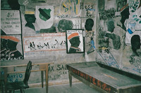 A typical cell at Heidelberg University's Student Prison contains a basic bed, table and chair—surrounded by colorful student artwork. Photo courtesy of Sharon Whitley Larsen.