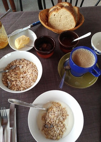A hearty breakfast at Alpe Rompiago in the Ticino area of Switzerland includes yogurt and oats, fresh-baked bread, butter and marmalade made on the farm. Photo courtesy of Athena Lucero.