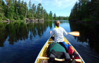 A canoeist plies the Boundary Waters between Minnesota and Canada. Photo courtesy of www.hansentravel.org.